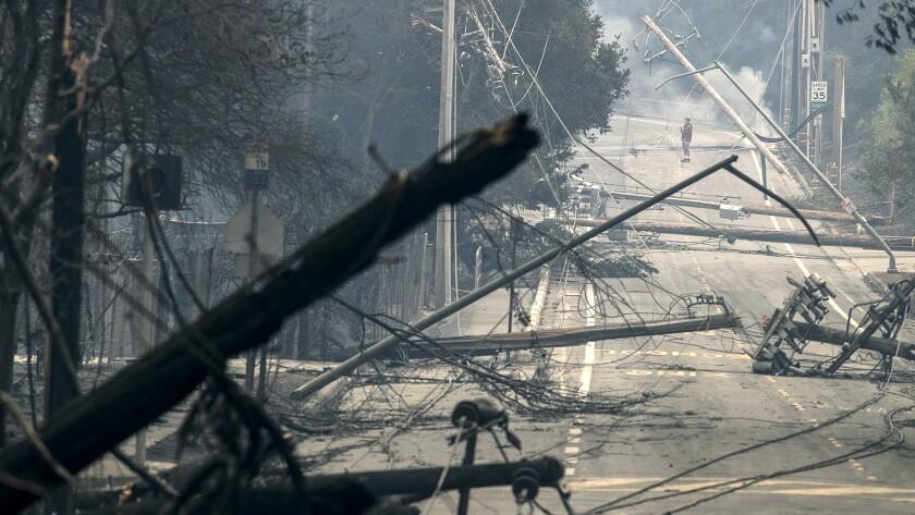 SANTA ROSA, CA -- MONDAY, OCTOBER 9, 2017: Power poles and lines block a street at Brookdale and Aa
