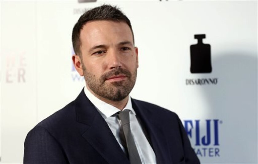 """FILE - In this Tuesday, April 9, 2013 publicity photo provided by Fiji Water, actor Ben Affleck arrives at the premiere of """"To The Wonder"""" hosted by FIJI Water, in Los Angeles. Affleck discusses his awkward Oscar speech and remembers film critic Roger Ebert at the premiere. (AP Photo/Fiji Water, Matt Sayles)"""