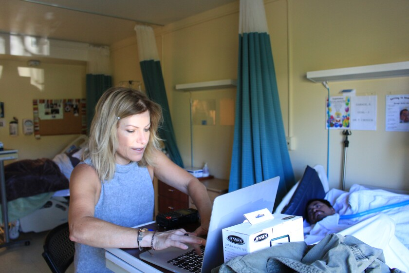 "Reporter Joanne Faryon inside the nursing home, using Google translate to try to speak with ""66 Garage"" in 2015."
