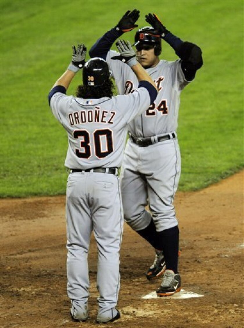 Detroit Tigers' Magglio Ordonez (30) greets Miguel Cabrera as he comes home after hitting a two-run home run scoring Ordonez during the seventh inning of a baseball game against the New York Yankees on Thursday, May 1, 2008, at Yankee Stadium in New York. (AP Photo/Bill Kostroun)