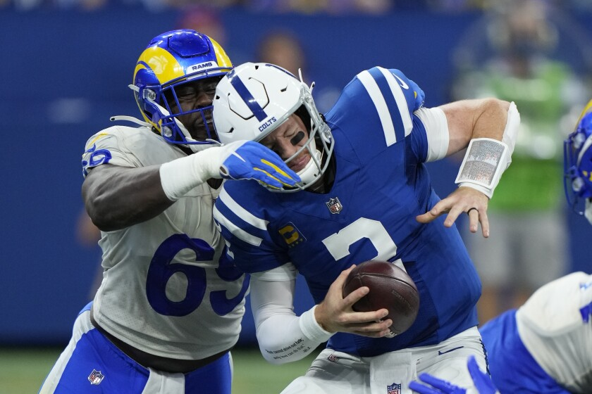 Indianapolis Colts quarterback Carson Wentz (2) is sacked by Los Angeles Rams' Sebastian Joseph-Day during the second half of an NFL football game, Sunday, Sept. 19, 2021, in Indianapolis. (AP Photo/AJ Mast)