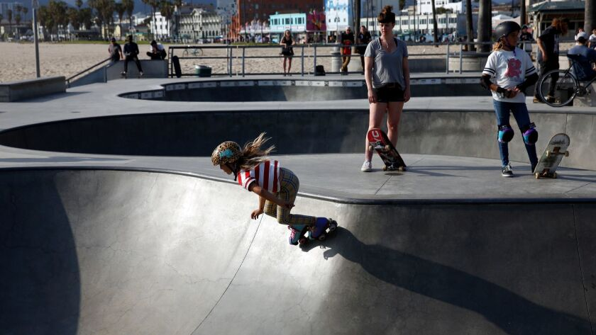 LOS ANGELES, CA-MAY 7, 2019: Liberty Lilley roller-skates down one of the bowls, with Anna May Dutto