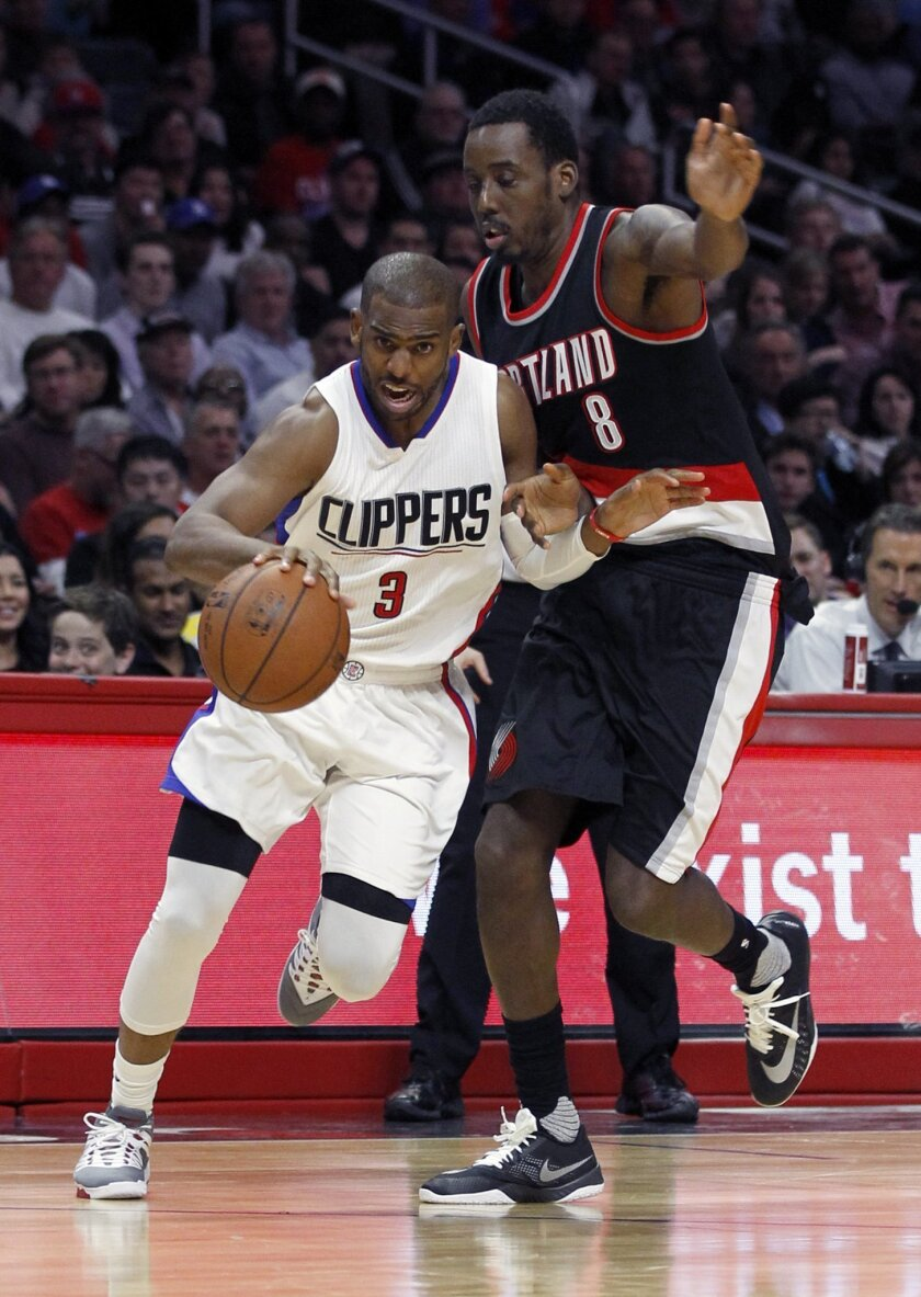 Los Angeles Clippers guard Chris Paul (3) bumps into Portland Trail Blazers forward Al-Farouq Aminu (8) as Paul dribbles past during the first half of an NBA basketball game in Los Angeles, Thursday, March 24, 2016. (AP Photo/Alex Gallardo)