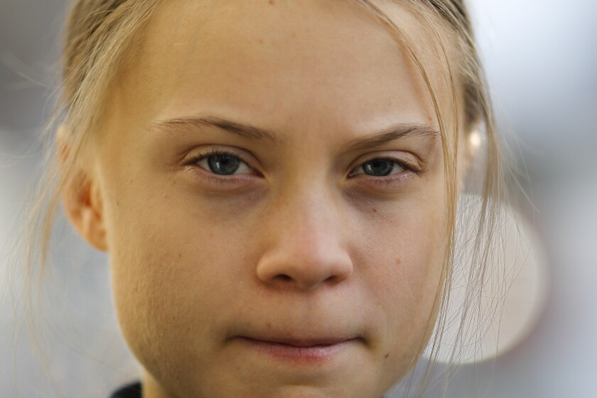 FILE - In this Jan. 24, 2020 file photo, Swedish climate activist Greta Thunberg poses for media as she arrives for a news conference in Davos, Switzerland. Swedish campaigner Greta Thunberg, is expected to take part in a climate protest in Berlin on Friday prior the general election next Sunday. (AP Photo/Markus Schreiber, File)