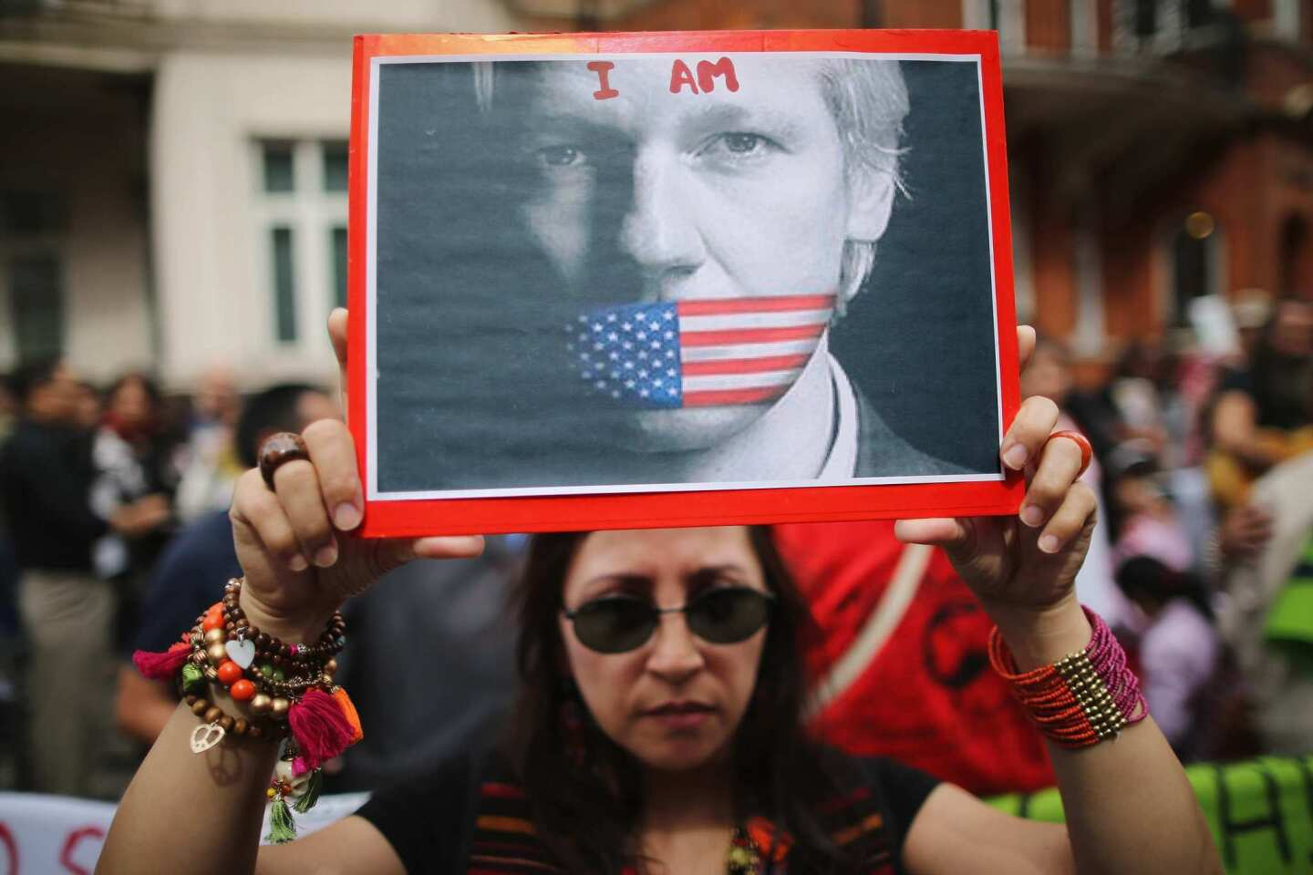 A Julian Assange supporter holds a sign outside the Ecuadorean Embassy in London in August 2012, a few weeks after Assange took refuge there.