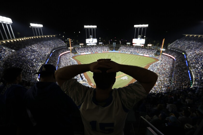 A Dodgers fan shows his frustration during Game 7 of the 2017 World Series.