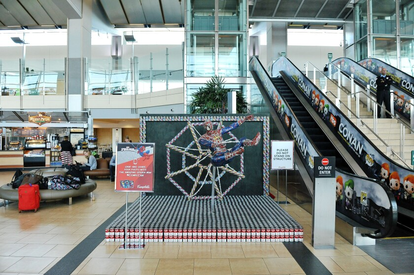 This Spider-Man in the baggage claim area of San Diego International Airport is made of Campbell's soup cans.