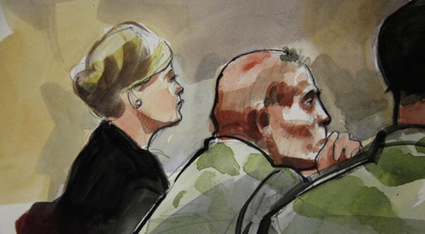 In this detail of a courtroom sketch, U.S. Army Staff Sgt. Robert Bales, center, is shown with attorney Emma Scanla during a preliminary hearing.