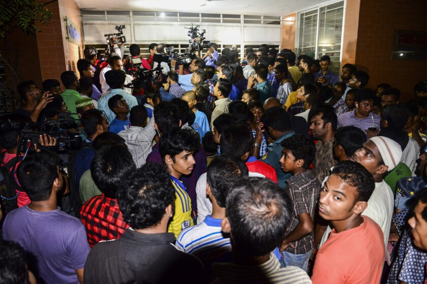 A crowd gathers outside the apartment building in Dhaka where Xulhaz Mannan, editor of Bangladesh's only LGBT magazine, was killed.