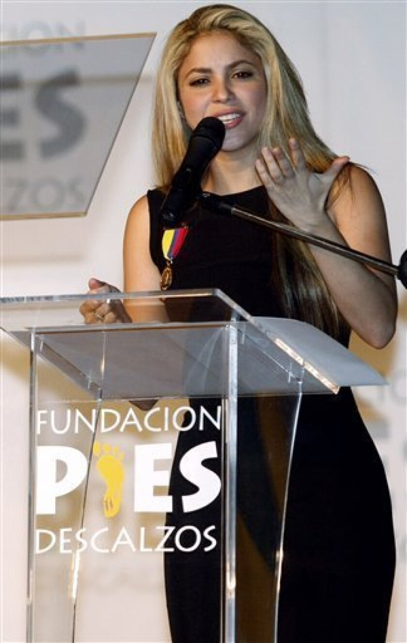"""Colombia's pop star Shakira delivers a speech during the inauguration of the fifth school her foundation """"Barefeet"""" has built, in Barranquilla, Colombia, Wednesday, Feb. 4, 2009. The school will host 1,800 students. (AP Photo/Jairo Castilla)"""