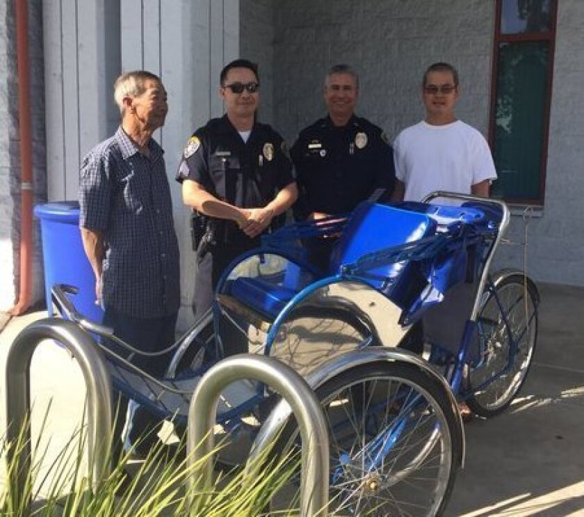 San Diego police officers returned the stolen cyclo to the Little Saigon Foundation Wednesday.