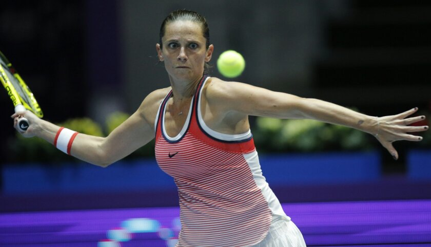 Roberta Vinci of Italy returns the ball to Ana Ivanovic of Serbia during the St. Petersburg Ladies Trophy-2016 tennis tournament semifinal match in St. Petersburg, Russia, Saturday, Feb. 13, 2016. (AP Photo/Dmitri Lovetsky)