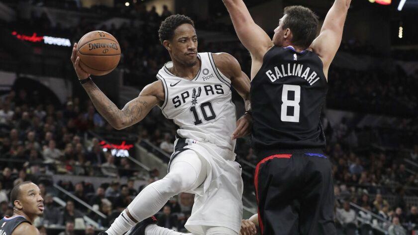 San Antonio Spurs guard DeMar DeRozan (10) drives past Clippers forward Danilo Gallinari (8) during the second half.