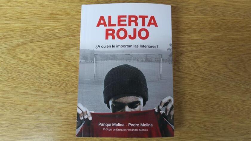 """A photo dated Jan. 9, 2019, showing the cover of """"Alerta Rojo"""" (Red Alert), a book that recounts the sexual abuse, theft, addiction, poverty, hunger, cold and overcrowded conditions endured over the past 20 years by aspiring players who have lived at Argentine soccer club Independiente's youth boarding house. EPA-EFE/Sebastian Meresman"""