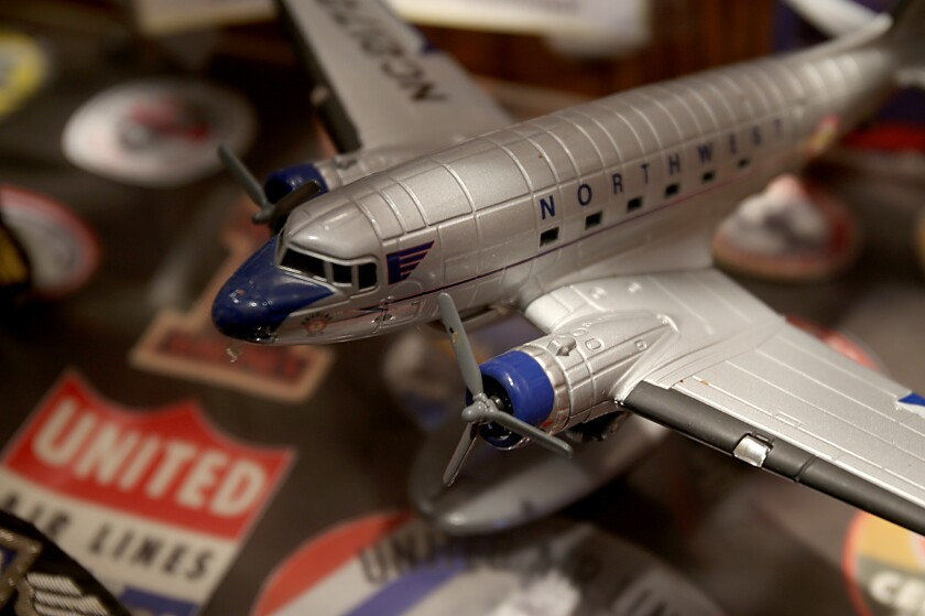 A display that commemorates the early days of commercial aviation is shown at the Proud Bird, an LAX-area hangout facing closure.