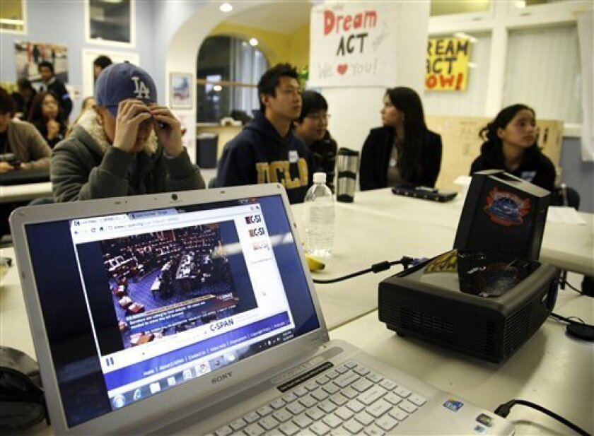 Undocumented college students and supporters watch the Senate's cloture vote on the Dream Act at the UCLA Downtown Labor Center in Los Angeles, Saturday, Dec. 18, 2010. The Dream Act would give provisional legal status to illegal immigrants brought to the country as children. (AP Photo/Jason Redmon