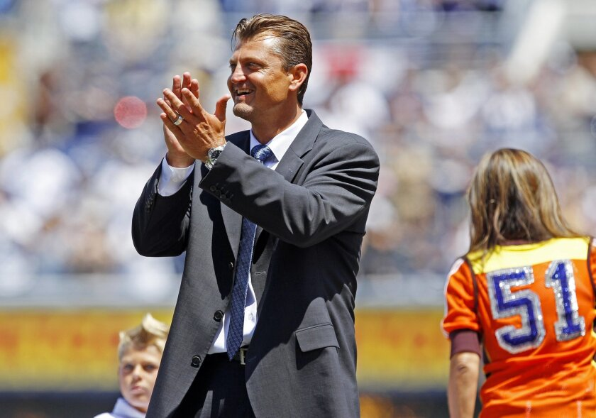Former padres pitcher Trevor Hoffman greets the crowd during a ceremony to have his number retired by the Padres.  (Photo by K.C. Alfred / The San Diego Union-Tribune)