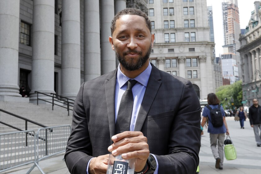 Former USC assistant coach Tony Bland leaves federal court in New York on Wednesday. Bland was the first of four ex-coaches charged with crimes to plead guilty to bribery conspiracy. He was sentenced to 100 hours of community service and two years of probation.