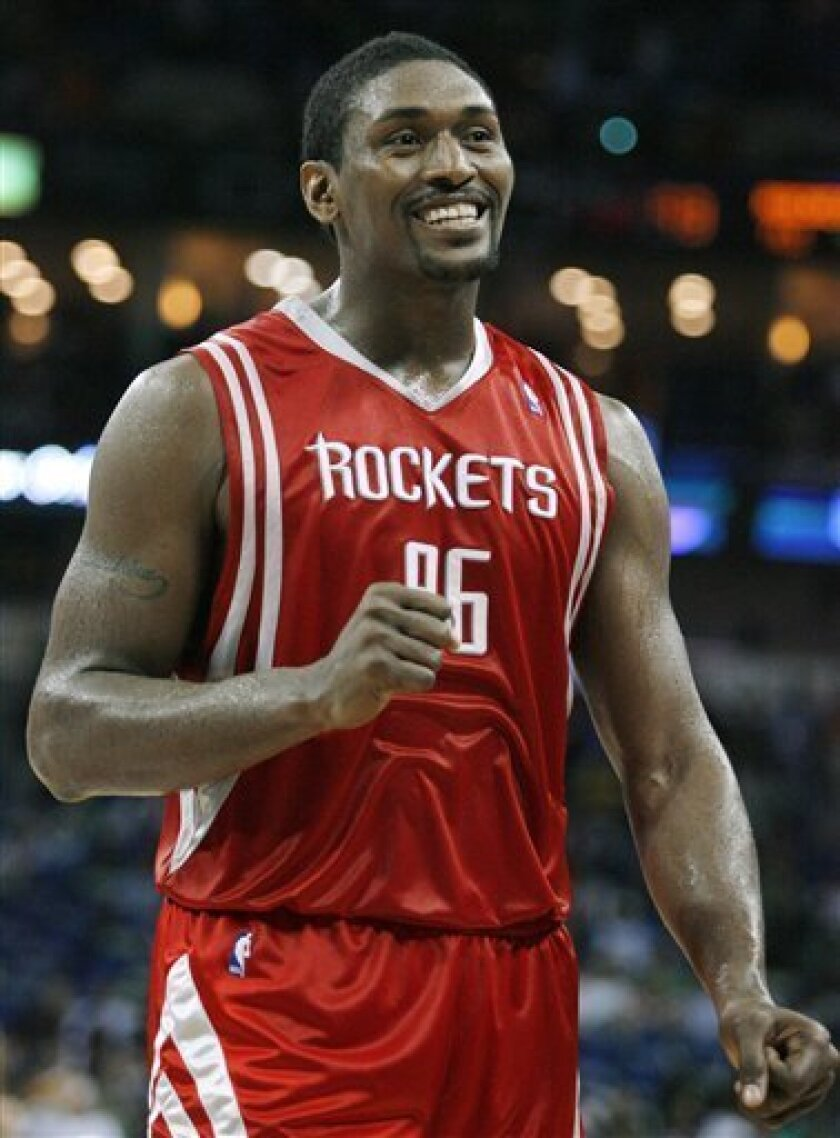 FILE - In this March 16, 2009, file photo, Houston Rockets forward Ron Artest smiles after a play during an NBA basketball game against the New Orleans Hornets in New Orleans. Artest is heading to the Los Angeles Lakers, according to various media reports Thursday, July 2, 2009. (AP Photo/Brian Lawdermilk, File)
