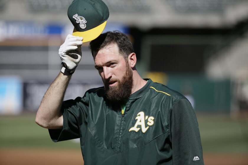 File - In this Monday, June 29, 2015 file photo, Oakland Athletics first baseman Ike Davis greets before the start of their baseball game against the Colorado Rockies in Oakland, Calif. Free-agent first baseman Davis has agreed to a minor league contract with the Texas Rangers and will report to ma