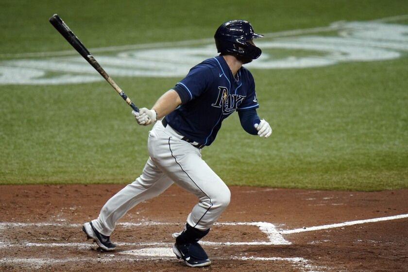 Tampa Bay Rays' Austin Meadows connects for a two-run double off Boston Red Sox pitcher Matt Hall during the fourth inning of a baseball game Friday, Sept. 11, 2020, in St. Petersburg, Fla. (AP Photo/Chris O'Meara)