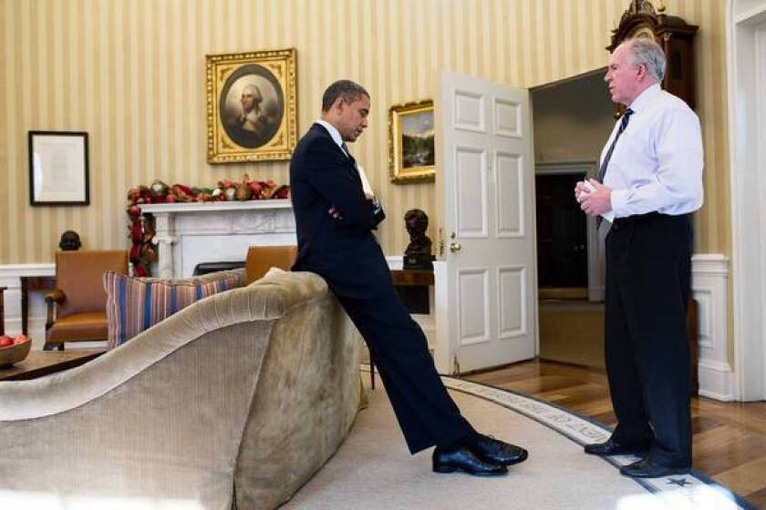 John Brennan, right, a deputy national security advisor, confers with President Obama. The president has nominated Brennan, a CIA veteran, to head the agency.