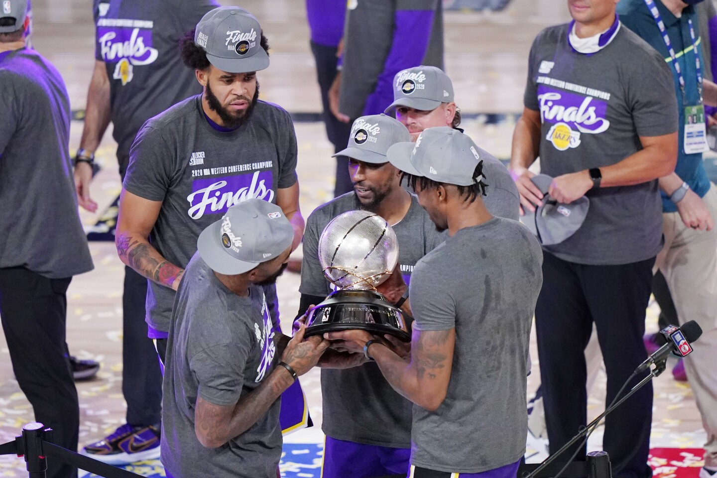 The Los Angeles Lakers celebrate after beating the Denver Nuggets in an NBA conference final playoff basketball game Saturday, Sept. 26, 2020, in Lake Buena Vista, Fla. The Lakers won 117-107 to win the series 4-1. (AP Photo/Mark J. Terrill)