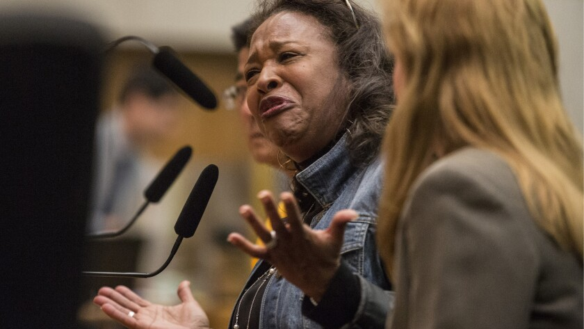 Reba Stevens, a former homeless woman, recounts her experiences as she pleads with the Los Angeles County Board of Supervisors to support a quarter-cent sales tax proposal.
