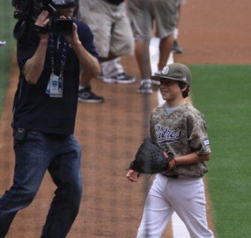 Evan Benham (Team Las Patronas) threw out the first pitch at PONY Day at Petco Park on Sunday.  Courtesy