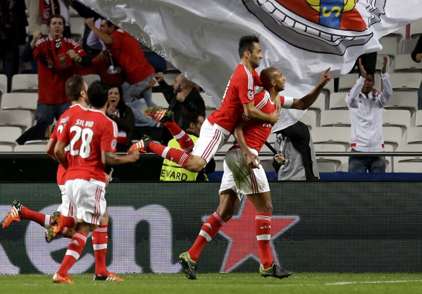 Benfica's scorer Luisao, right, and teammates celebrate their side's 2nd goal during the Champions League group C soccer match between Benfica and Galatasaray at the Luz stadium in Lisbon, Portugal, Tuesday, Nov. 3, 2015.  (AP Photo/Armando Franca)