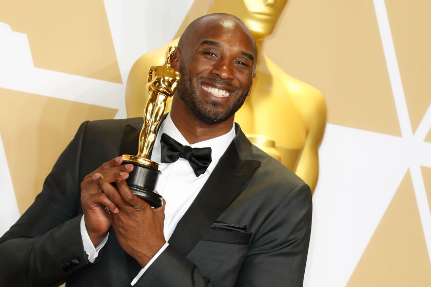 "Kobe Bryant holds his 2018 Oscar for ""Dear Basketball,"" which won for best animated short film."