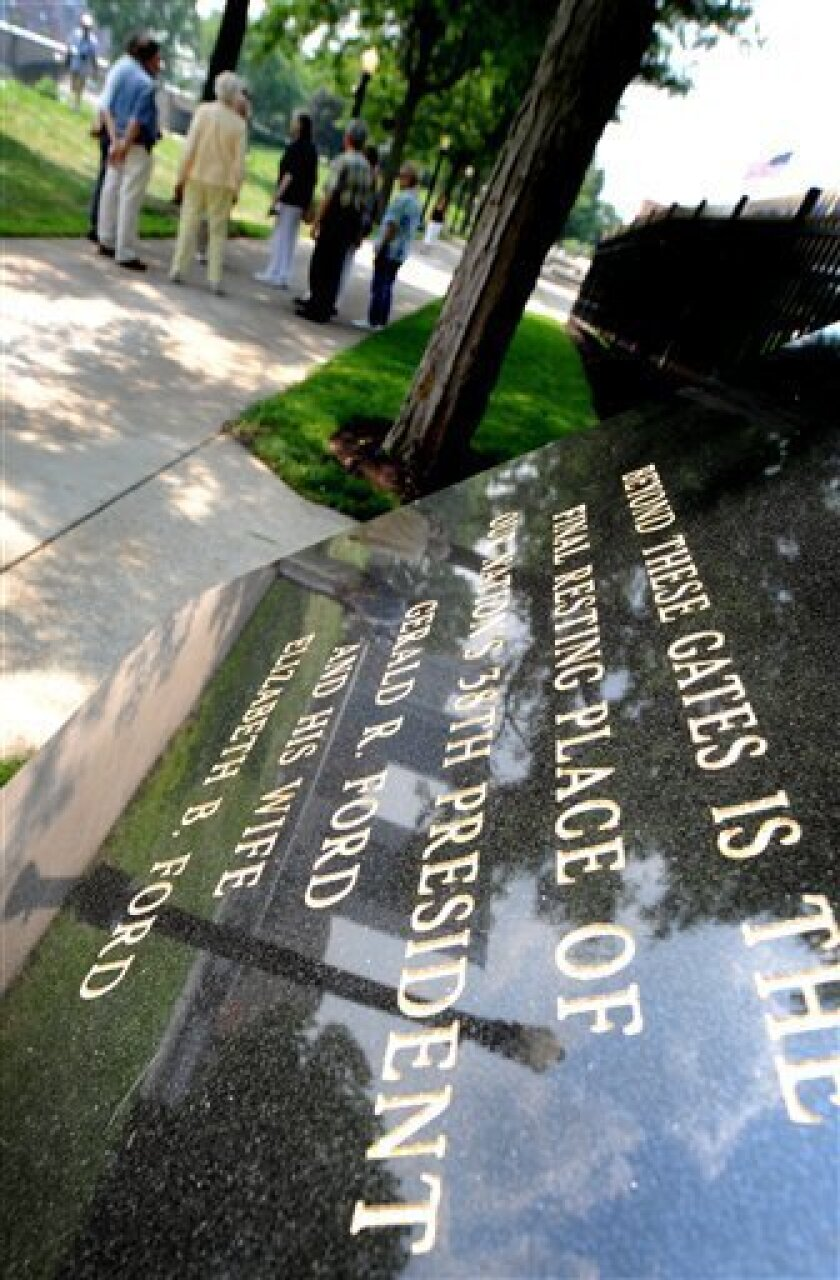 People gather to show support outside of the gates of the gravesite for Betty Ford at the Gerald R. Ford Presidential Museum in Grand Rapids, Mich., Sunday, July 10, 2011. The former first lady died Friday at the age of 93. (AP Photo/The Grand Rapids Press, Katy Batdorff)