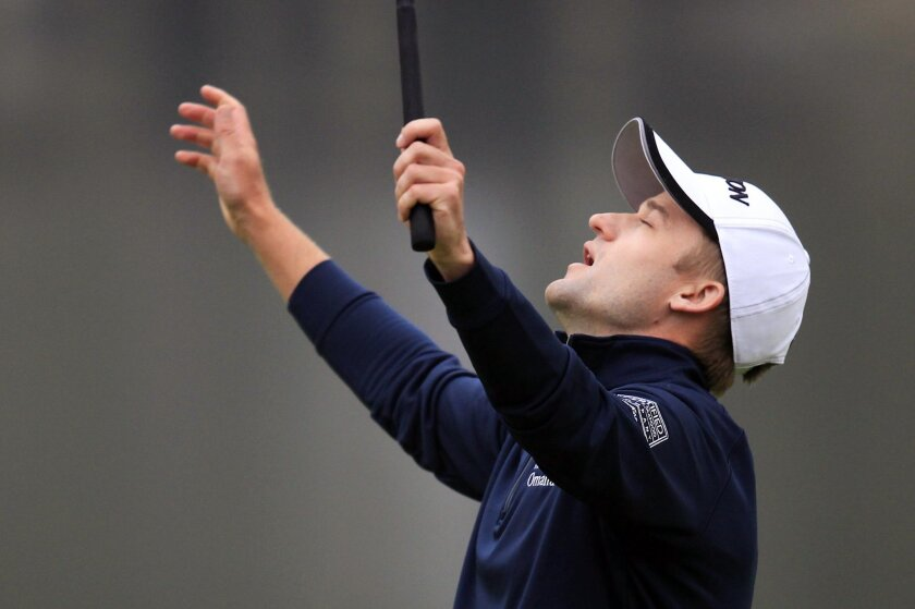 Russell Knox of Scotland celebrates on the 18th hole after the final round of the HSBC Champions golf tournament at the Sheshan International Golf Club in Shanghai, China Sunday, Nov. 8, 2015. (AP Photo)