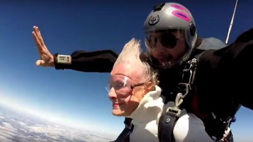 Looking remarkably calm, Jeanne Warnke celebrates her 90th birthday by jumping from an airplane at S