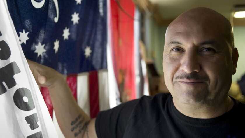 Hector Barajas stands in the doorway of the Deported Veteran's Support House (The Bunker) on Novembe