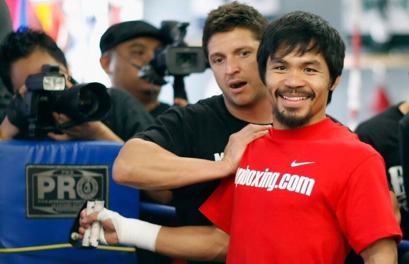 Alex Ariza (left) with Manny Pacquiao in 2011.