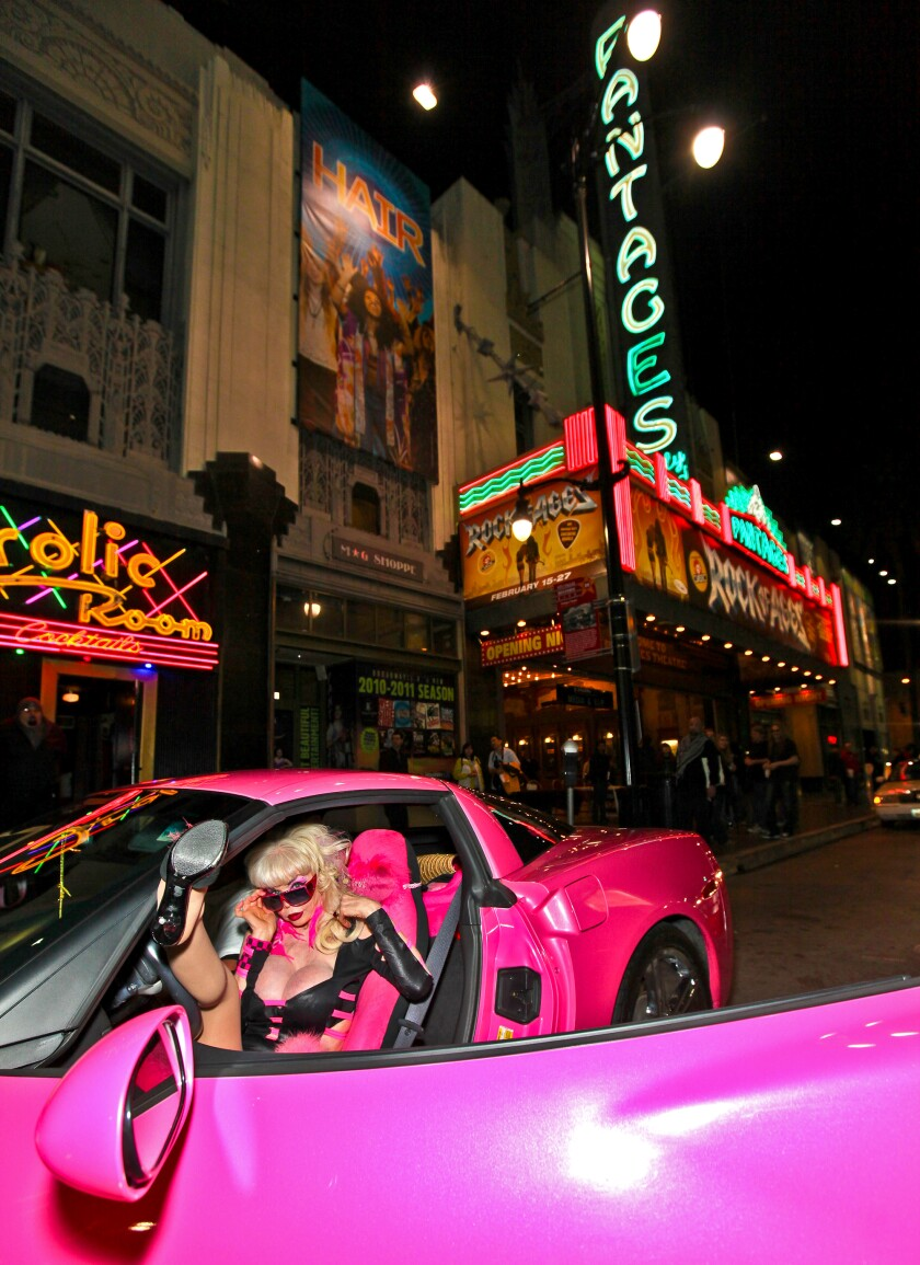 """Angelyne in her pink Corvette at the opening night of """"Rock Of Ages"""" at the Pantages Theatre"""