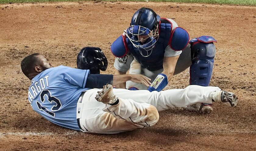 Dodgers catcher Austin Barnes tags Tampa Bay Rays baserunner Manuel Margot as he tries to steal home in Game 5.
