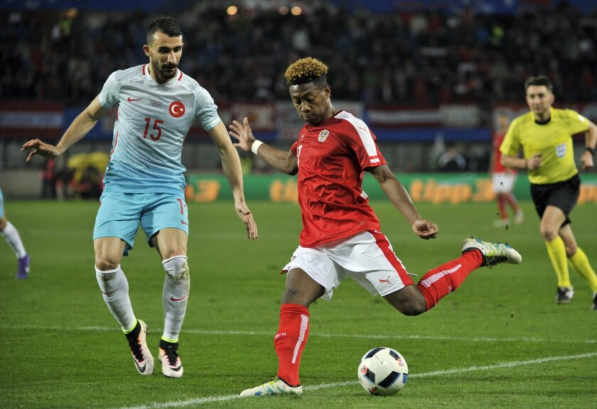 FILE - In this Tuesday, March 29, 2016 filer, Austria's David Alaba, right, and Mehmet Topal of Turkey challenge for the ball during an international friendly soccer match between Austria and Turkey in Vienna, Austria. (AP Photo/Hans Punz, File)