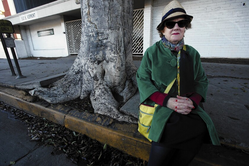 Deborah Murphy, executive director of Los Angeles Walks, a pedestrian advocacy group, is trying to get the city to repair sidewalks as well as the streets.