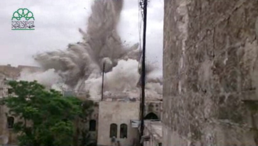 Amateur video posted by Syrian opposition activists shows an explosion that destroyed the Carlton Citadel Hotel in Aleppo.