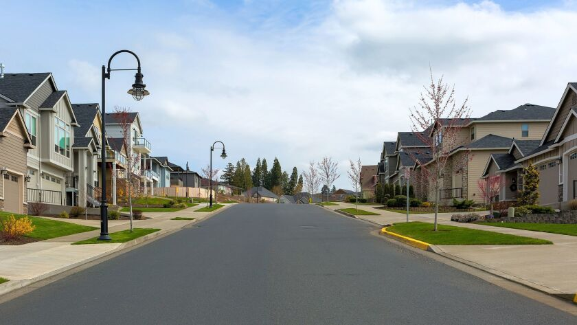 New North American suburban upscale neighborhood homes along street in Happy Valley OR USA