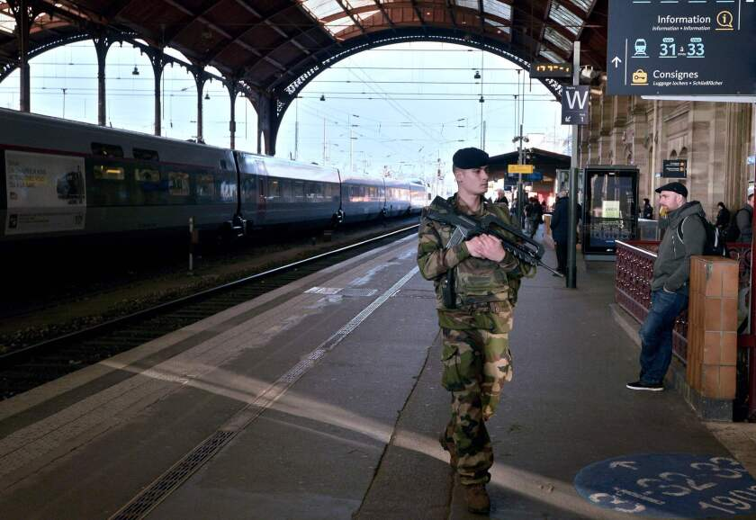 French soldier patrols station