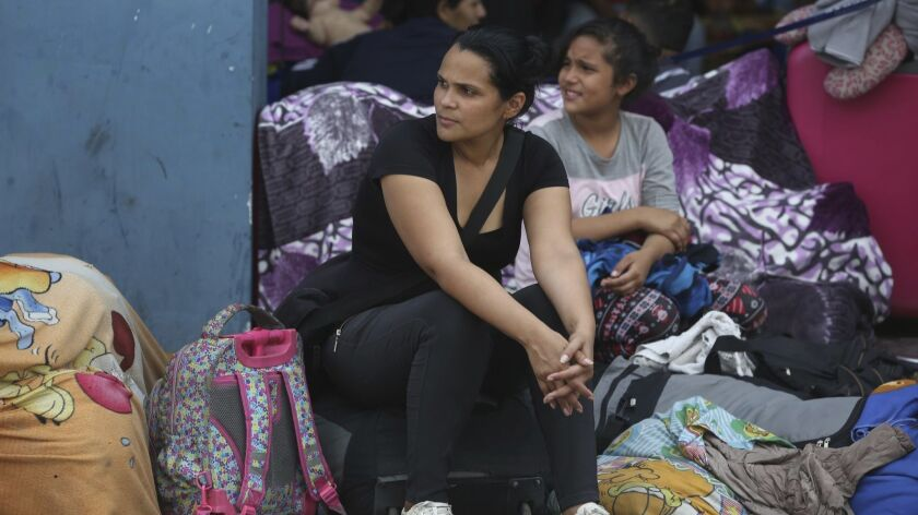 Venezuelan migrant Alejandra Zambrano, who said she's an unemployed journalist, waits for her turn t