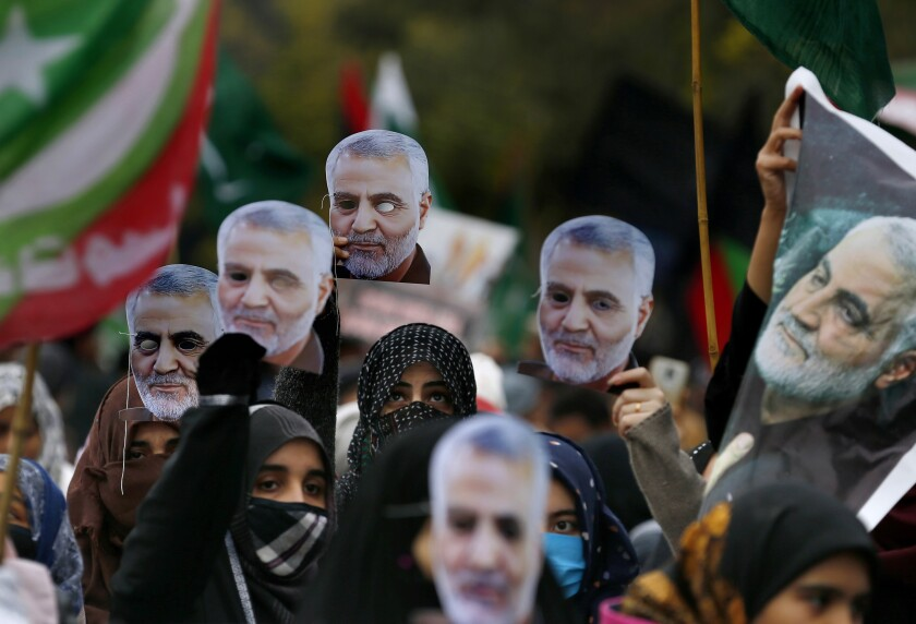 """Pakistani Shiite Muslims hold cut out masks of Iranian Revolutionary Guard Gen. Qassem Soleimani during a rally to condemn his killing by a U.S. airstrike in Iraq, in Islamabad, Pakistan, Sunday, Jan. 5, 2020. Iran has vowed """"harsh retaliation"""" for the U.S. airstrike near Baghdad's airport that killed Tehran's top general and the architect of its interventions across the Middle East, as tensions soared in the wake of the targeted killing. (AP Photo/Anjum Naveed)"""