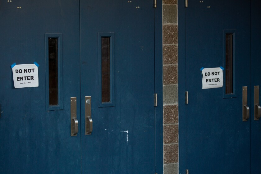 """Do Not Enter"" signs mark the doors to Bothell (Wash.) High School."