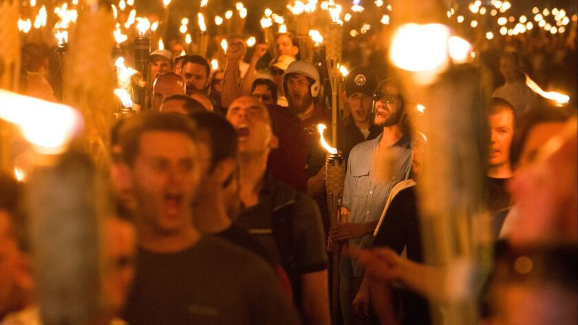 White nationalists and other far-right groups march in Charlottesville, Va., in August 2017. Donations to the Daily Stormer spiked around that time.