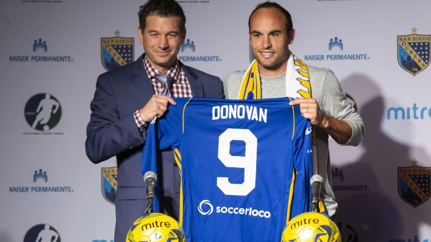 San Diego Sockers coach Phil Salvagio (left) presents Landon Donovan with his new No. 9 team jersey during his introduction Thursday.