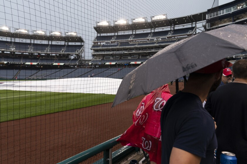 Fans gather to leave a postponed baseball game between the Washington Nationals and the San Francisco Giants at Nationals Park, Thursday, June 10, 2021, in Washington. The game was postponed until Saturday June 12th. (AP Photo/Alex Brandon)