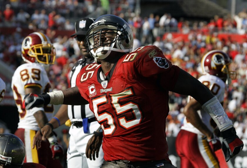 FILE - In this Nov. 25, 2007 file photo, Tampa Bay Buccaneers' Derrick Brooks reacts after the defense stopped the Washington Redskins on a fourth and inches during the third quarter of an NFL football in Tampa, Fla. Brooks will be inducted into the Pro Football Hall of Fame Saturday, Aug. 2, 2014,